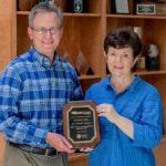 CFO Scott MacArthur presents the 1 millionth customer plaque to Elizabeth Kelly.